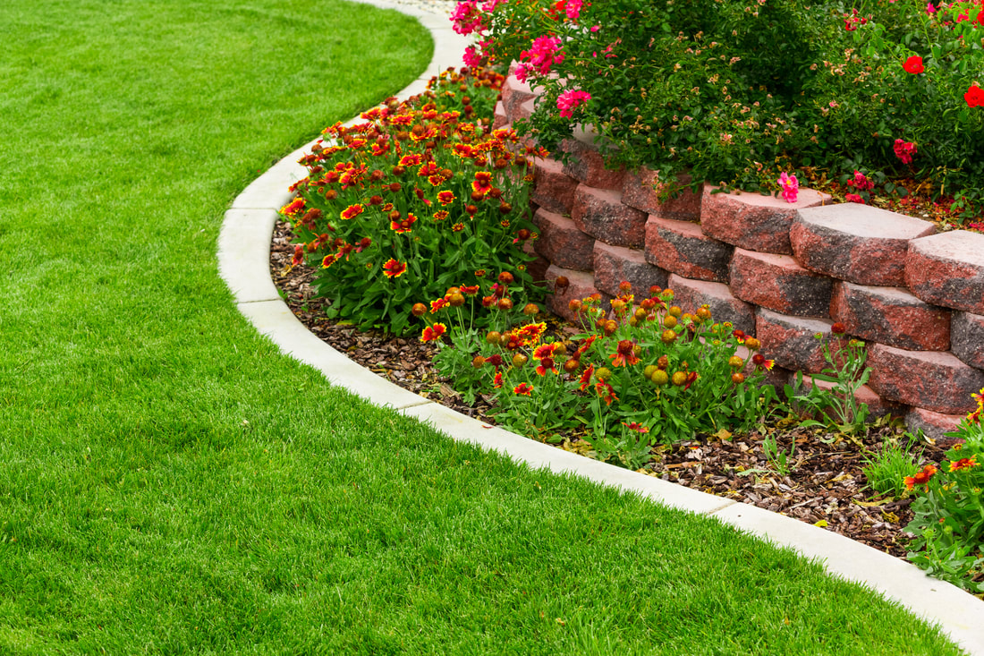 Augusta Lawn Care and Maintenance offer mulch services to help insure your flower beds stay healthy year-round.